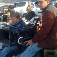 James Suttles behind the camera on the music video Carolina Moonshine with NASCAR legend Junior Johnson